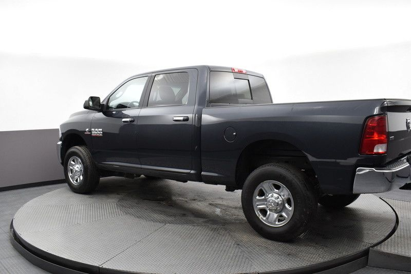 Rear driver's side view of the gray 2018 Ram 2500 SLT 4WD