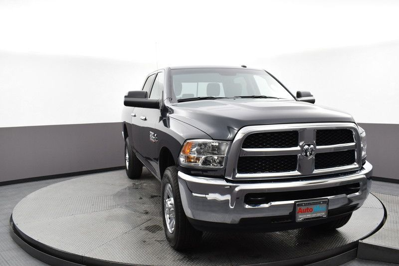 Front passenger's side view of the gray 2018 Ram 2500 SLT 4WD