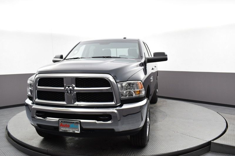 Front driver's side view of the gray 2018 Ram 2500 SLT 4WD
