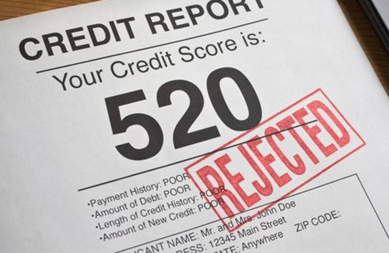 Credit report with a 520 credit score and rejected on it