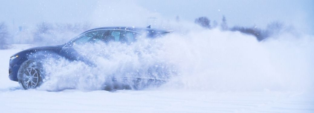 vehicle driving through snow