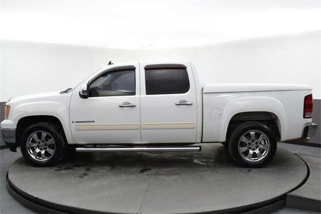 Side view of white 2008 GMC Sierra SLE1