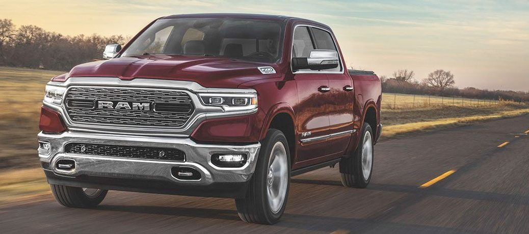Maroon 2020 Ram 1500 driving on a straight road