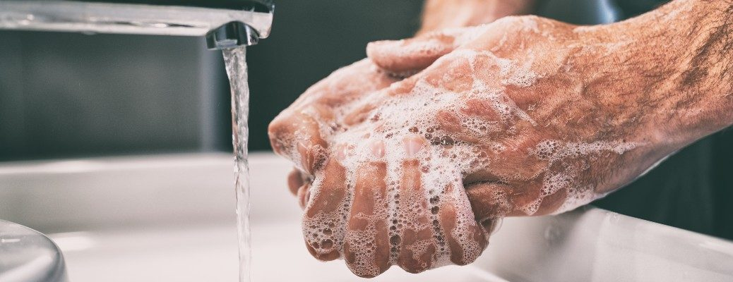 hands washing at sink with soap