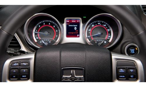 2020 Dodge Journey interior close up on instrument cluster seen through steering wheel