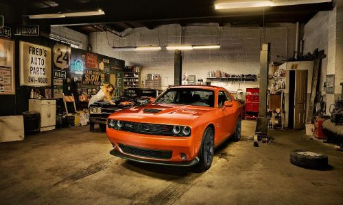 2020 Dodge Challenger orange in a garage