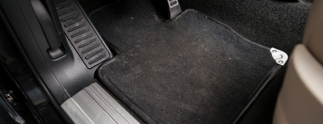 stock photo of dirty car floor mat