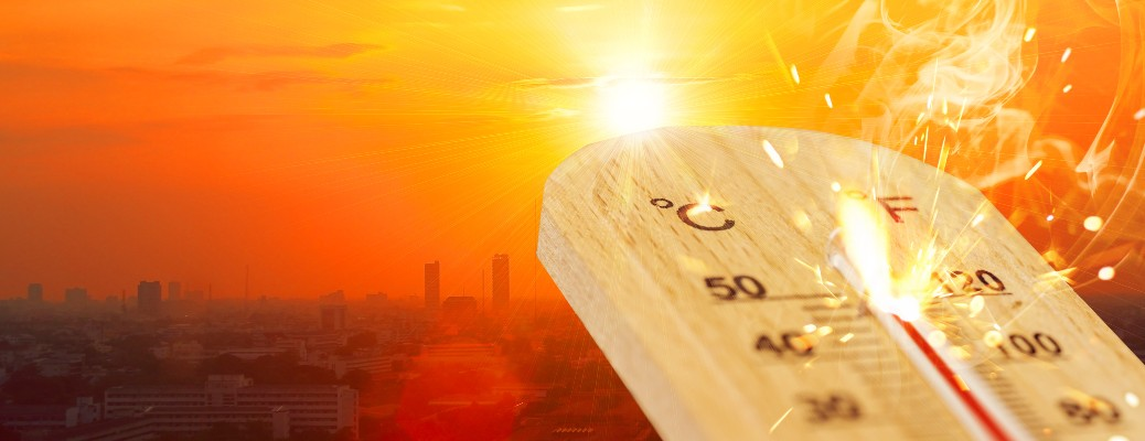 stock photo of hot thermometer and city sunset