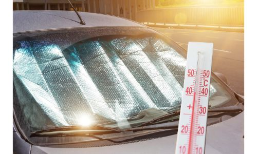 reflective sun shade under windshield sun flare and thermometer