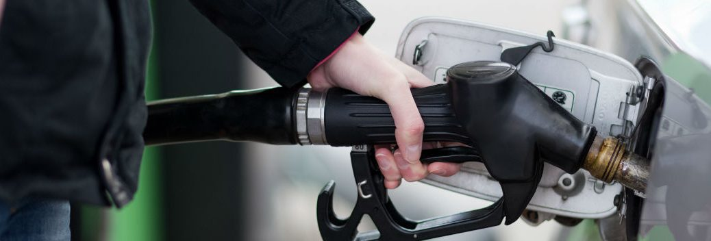 filling up vehicle at gas station