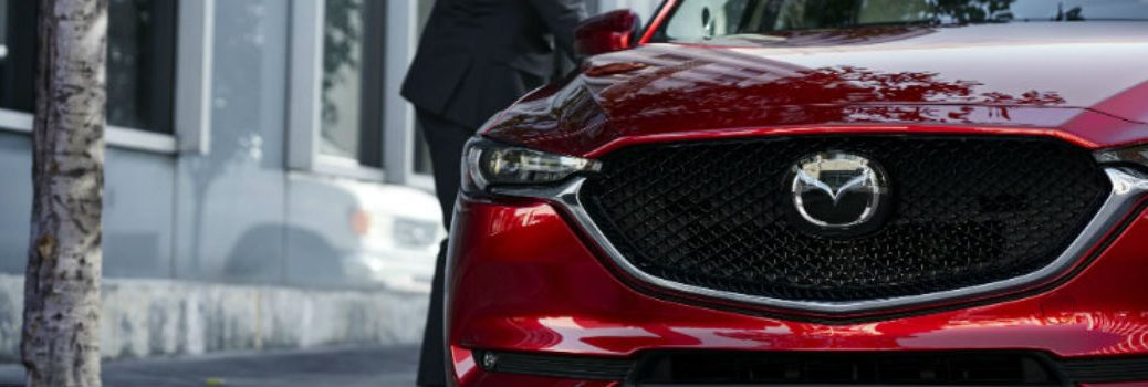 red Mazda vehicle front grille