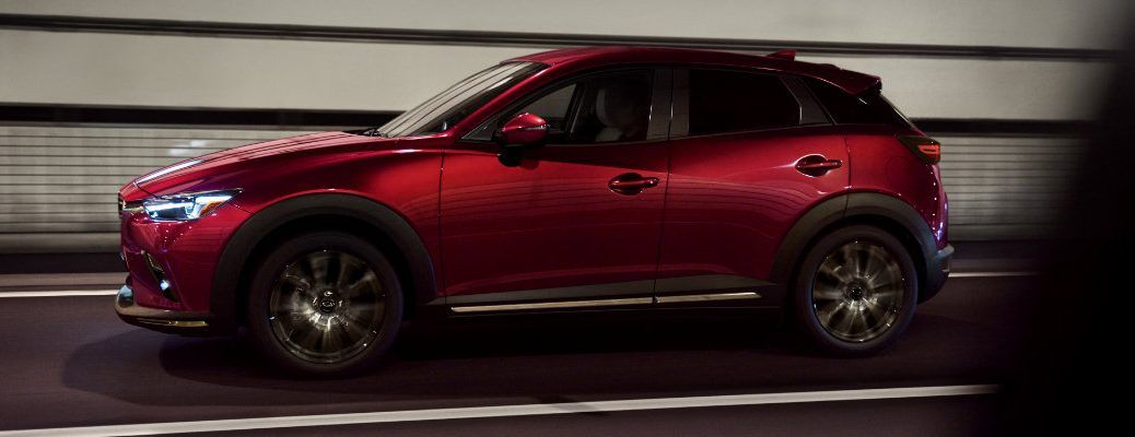 2019 Mazda CX-3 exterior side shot red paint job driving through a lit tunnel