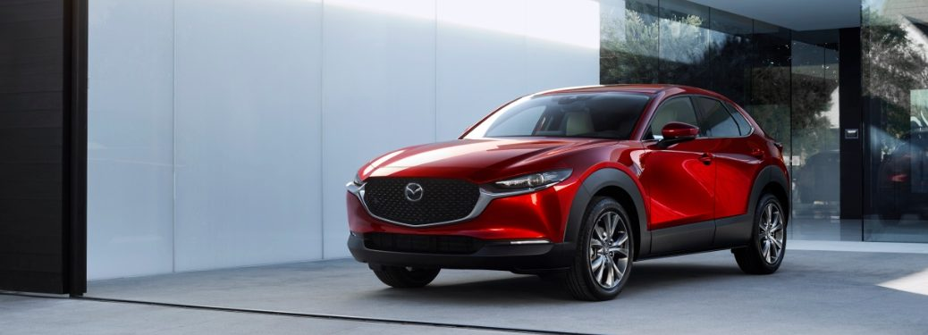red mazda cx-30 outside a home