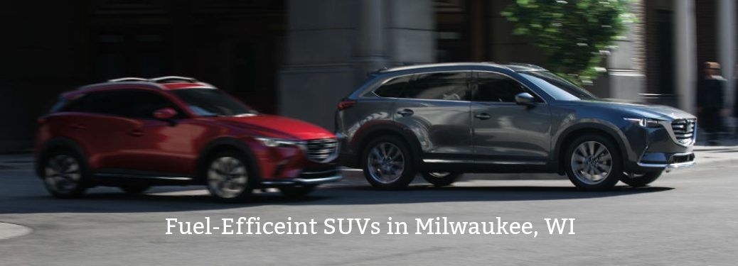 Fuel -Efficient SUVs in Milwaukee, WI, text below a driver side exterior image of a red and a gray 2019 Mazda CX-9