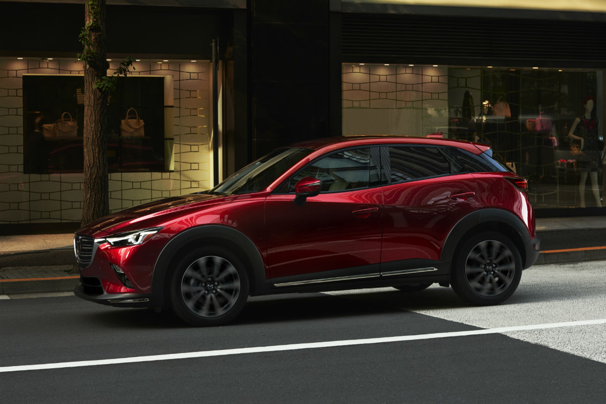 Driver side exterior view of a red 2019 Mazda CX-3