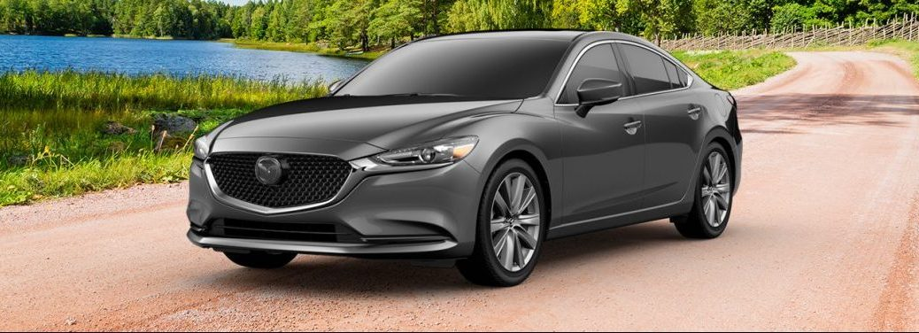 A gray 2019 Mazda6 sits out on a trail in the middle of nature.