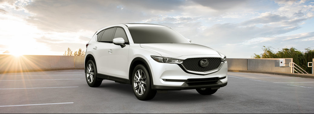 White 2019 Mazda CX-5 parked atop a parking ramp.