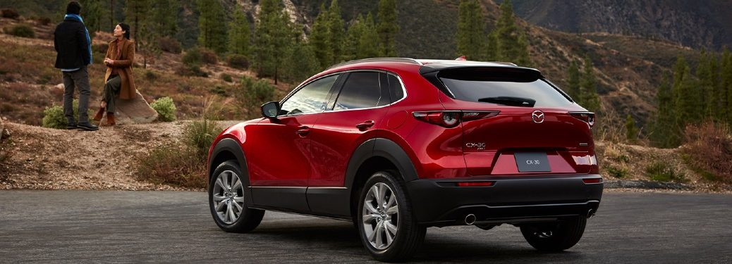 2020 CX-30 parked near mountains with two people talking in front of it