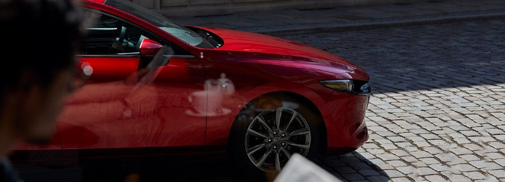 2020 Mazda Hatch front end seen through cafe window