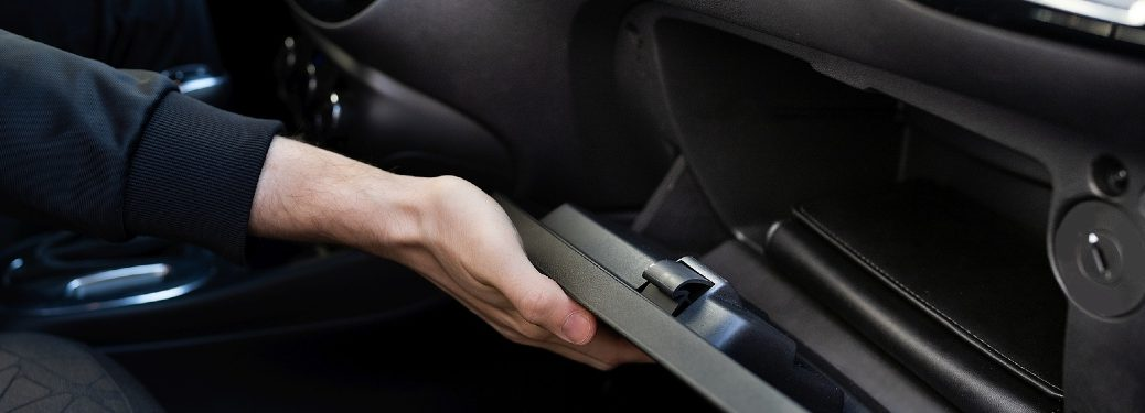 person opening glove box