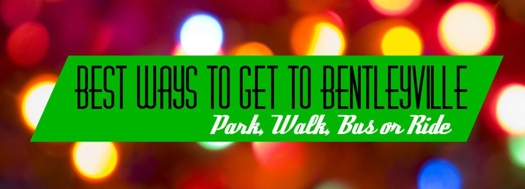 """words """"Best ways to get to Bentleyville: park, walk, bus or ride on green with blurry Christmas lights in the background"""