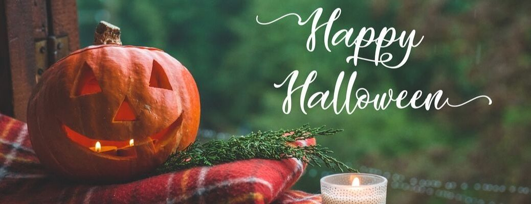 Happy Halloween banner with a Jack-o-Lantern on a flannel blanket