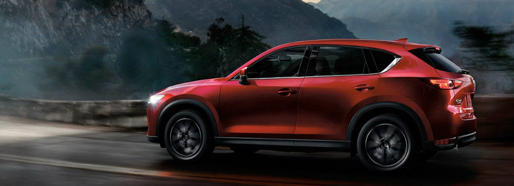 2018 Mazda CX-5 side exterior on road at night