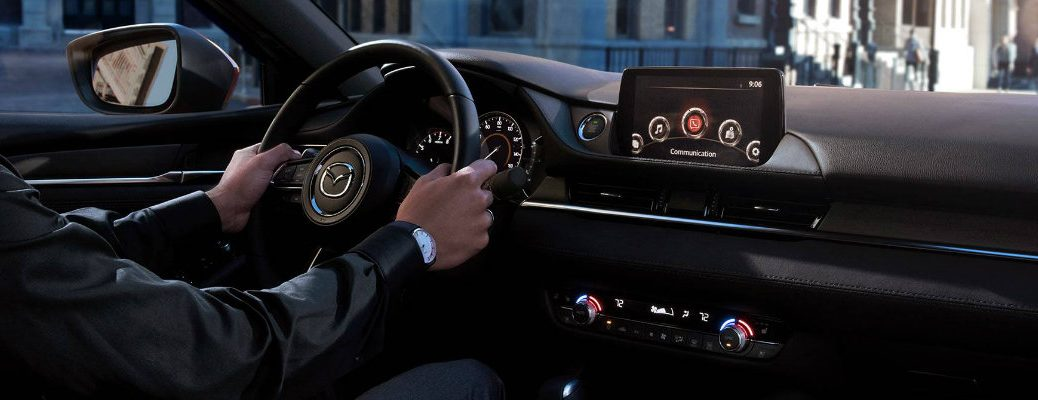 Man driving in 2018 Mazda6 with center touchscreen in view
