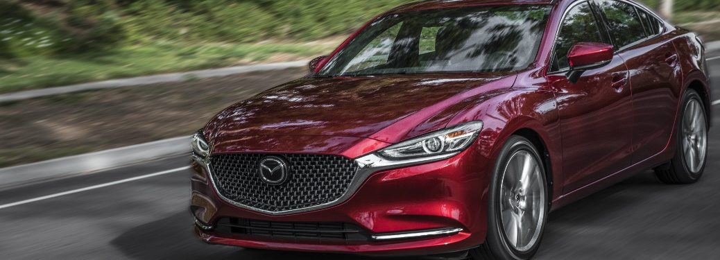 red Mazda6 on the road