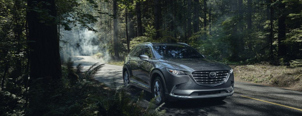 Grey 2021 Mazda CX-9 driving in forest