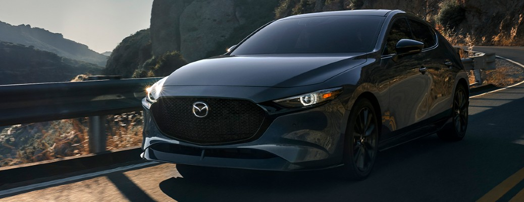 2021 Mazda3 Hatchback front view on a road