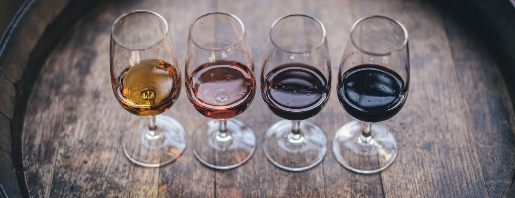Four glasses of wine kept in a table for tasting