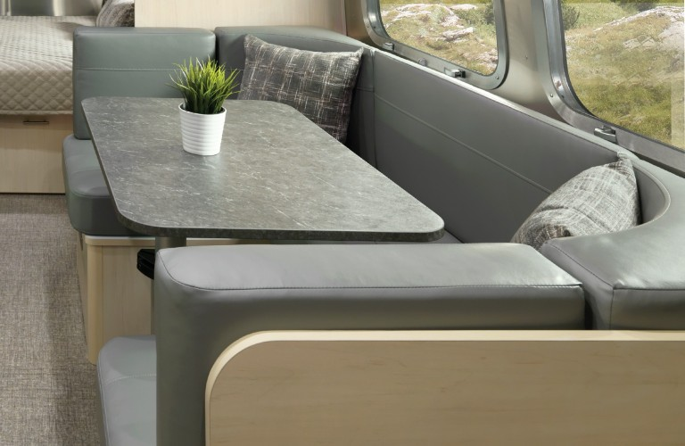 The interior view of the all-new decor scheme on the dinette inside the 2021 Airstream Flying Cloud.