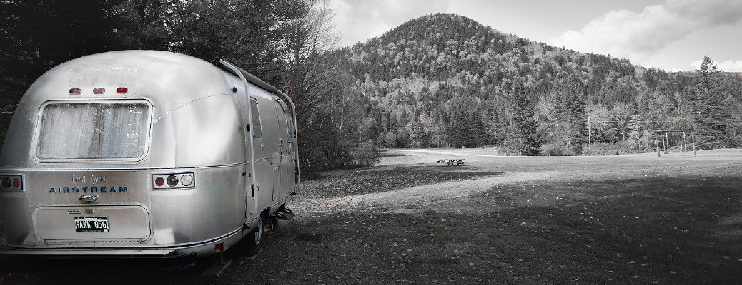 Airstream parked in clearing black and white photograph