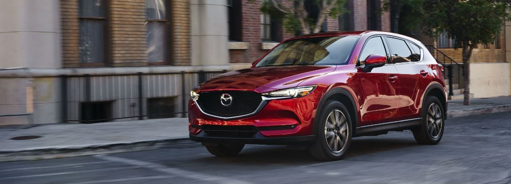 Front exterior view of a red 2018 Mazda CX-5