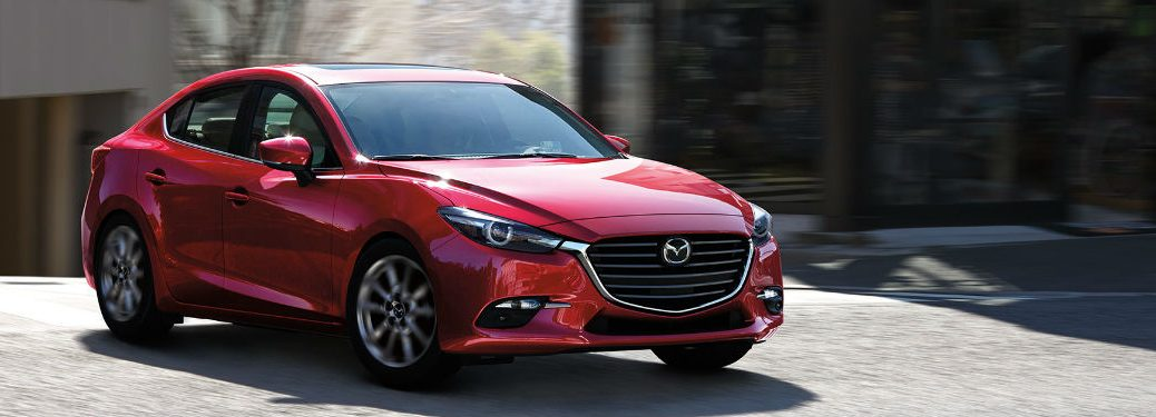 Front exterior view of a red 2018 Mazda3