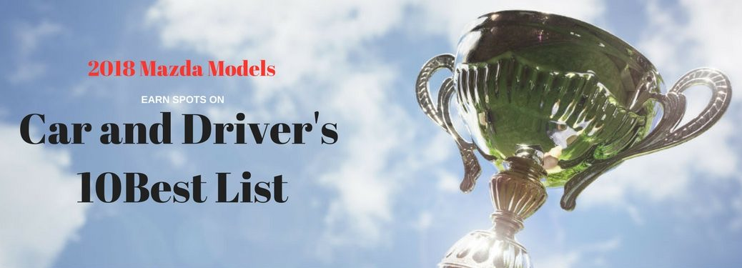 2018 Mazda Models earn spots on Car and Driver's 10Best List, text on an image of a trophy being held up into the sunlight