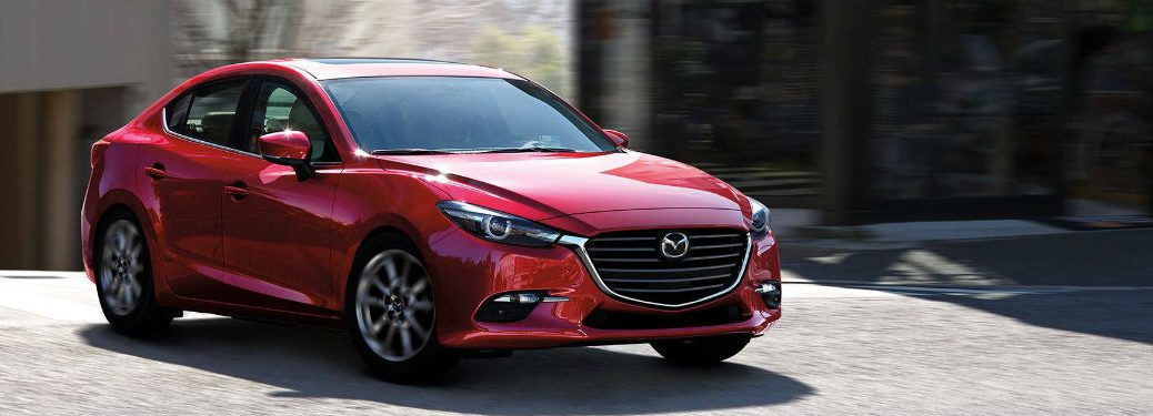 Passenger side exterior view of a red 2018 Mazda3