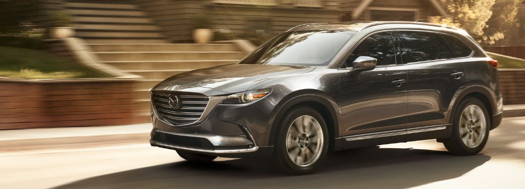 Front driver side exterior view of a gray 2019 Mazda CX-9