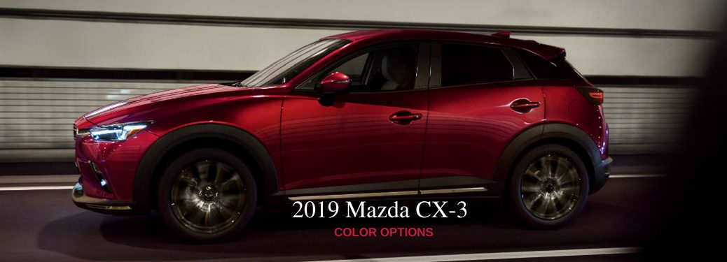 2019 Mazda CX-3 Color Options, text on an driver side exterior image of a red 2019 Mazda CX-3