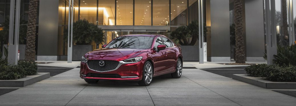 Front driver side exterior view of a red 2018 Mazda6