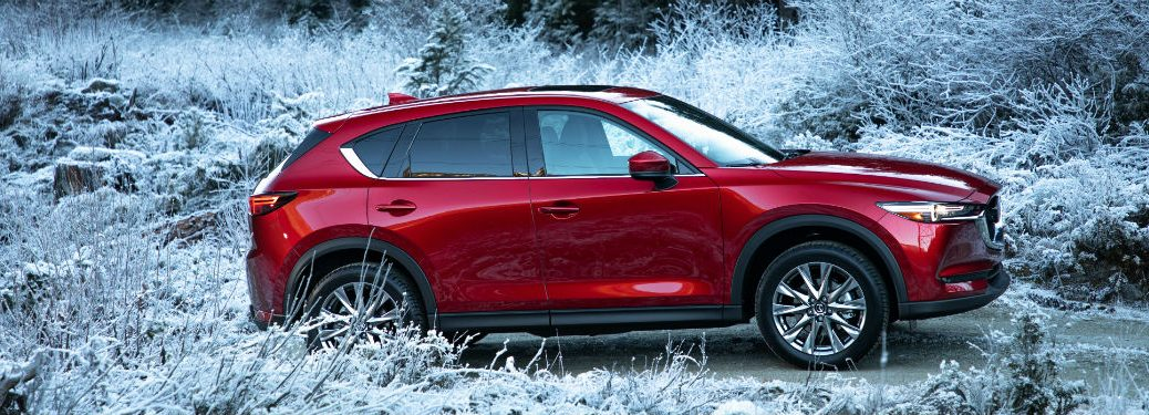 Passenger side exterior view of a red 2019 Mazda CX-5