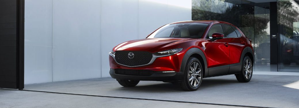 Front driver side exterior view of a red 2020 Mazda CX-30