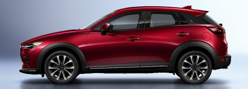 Driver side exterior view of a red 2019 Mazda CX-5