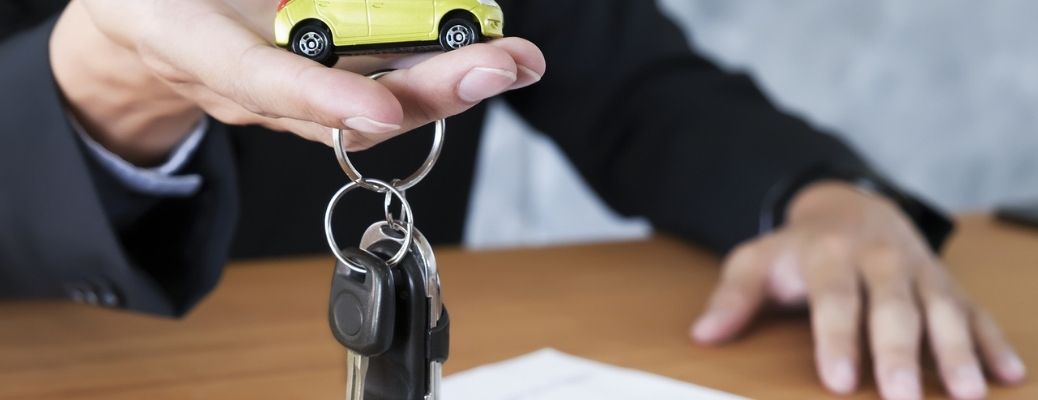 A man holding car keys in his hands