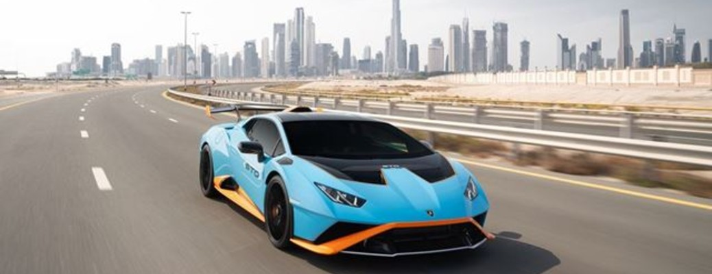 Lamborghini Huracan STO driving out of a city