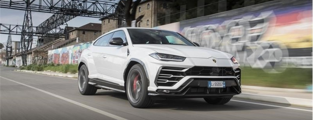 The front and side view of a white Lamborghini Urus.