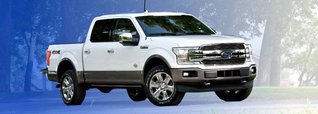 2018 Ford F 150 In White Driving Front Of Blue To Grant