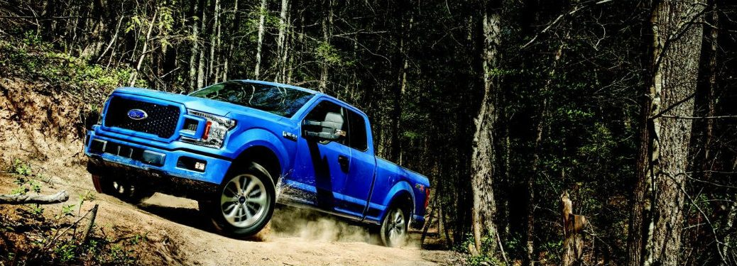 Lightning Blue  Ford F  Stx Driving Through Woods