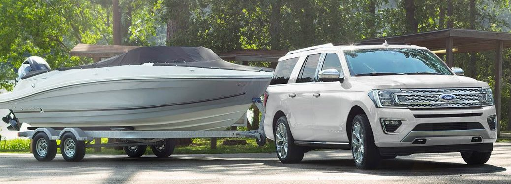 White 2019 Ford Expedition towing a boat